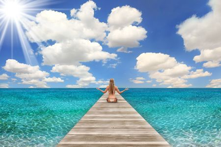 Pretty Beach Scene on a Bright Day With Woman Meditating