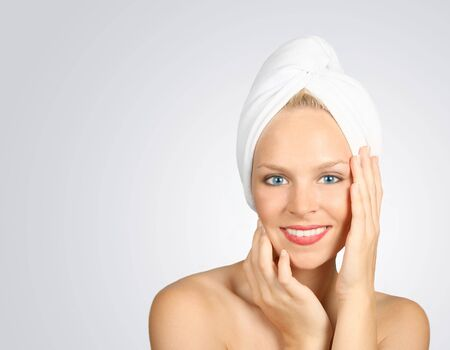 Blue Eyed Woman With a Towel on Hair Awaiting Spa Treatment photo