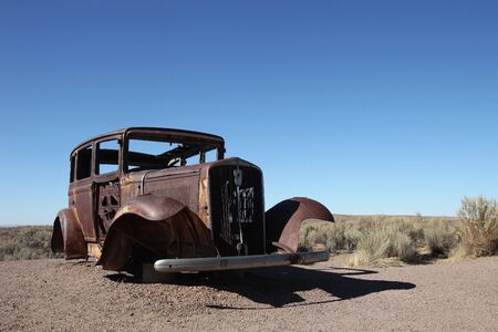 abandoned car: Abandoned Vintage Rusted Car Outdoors in Bright Sun