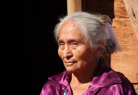 Navajo Elderly Woman Outdoors in Bright Sun