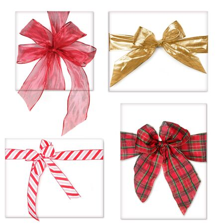 Four Tied Beautiful Christmas Gifts With Bows On White
