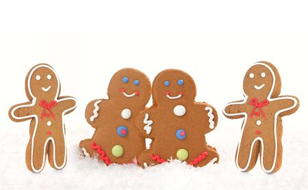 Four Gingerbread Men and Women on White Background photo