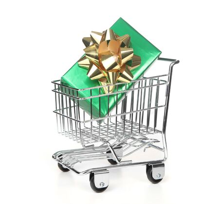 Pristine Grocery Shopping Cart With Wrapped Holiday Gift Inside Stock Photo - 6159887
