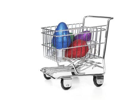 Grocery Shopping Cart With Ornaments In the Basket on White Stock Photo - 6159892