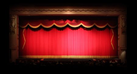 Real Stage Theater Drapes With Spotlights. Image has some noise due to low lighting conditions. Stock Photo