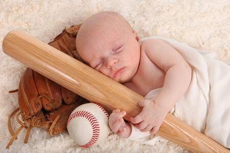 Sweet Little Baby Boy Holding a Baseball Bat With Glove and Ball 版權商用圖片