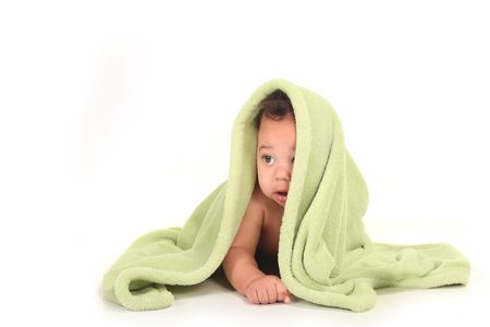 Beautiful Baby Boy Looking Sideways With Blanket on Top of His Head Stock Photo - 6836633