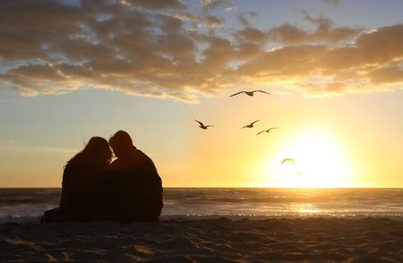 Loving Happy Couple Watching the Sunset in Love on the Beach Stock Photo - 6864459