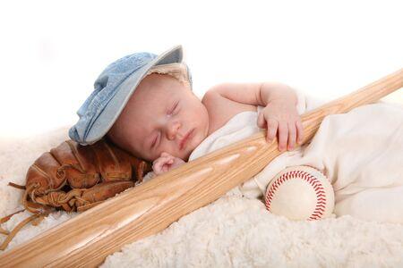 swaddled: Sleeping Infant Boy Holding Baseball Bat and Ball on White Background