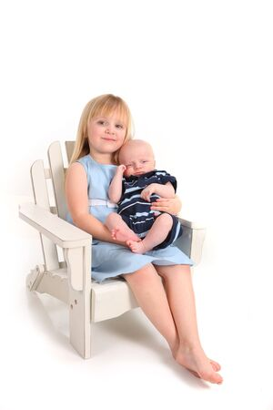 Big Sister Holding Her Newborn Baby Brother on White Stock fotó