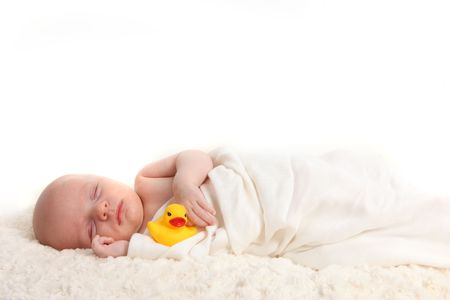 duckie: Sleeping Swaddled Infant Holding a Rubber Duckie on White Background