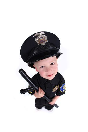 safety officer: Funny Adorable Image of a Child Police Officer Holding a Night Stick Stock Photo