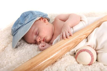 swaddled: Infant Baby Boy Sleeping With a Baseball Bat and Ball