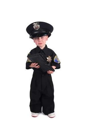 Unhappy Child Dressed as a Police Officer Crying on a White Background photo