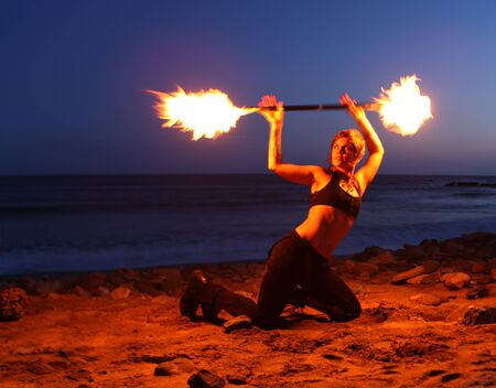 poi: Firedancer with torch on the beach