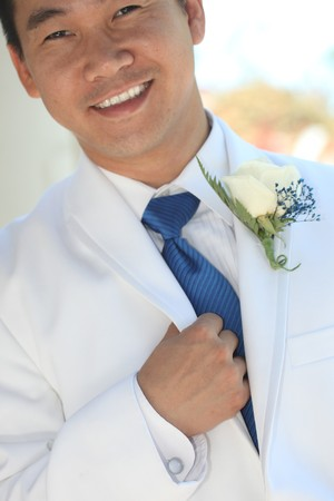 Groom Wearing a White Tuxedo and Blue Tie on His Wedding Day Stock Photo - 8059250