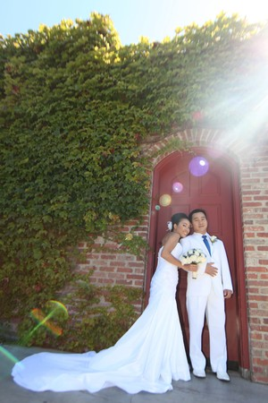 Beautiful Portraits of a Bride and Groom Couple on Their Wedding Day With Intentional Sunflare Stock Photo - 8057240