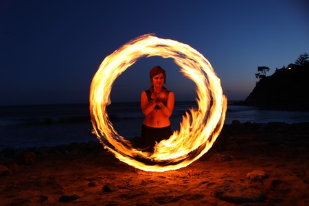 Beautiful Fire Dance Along the Beach in the Dark