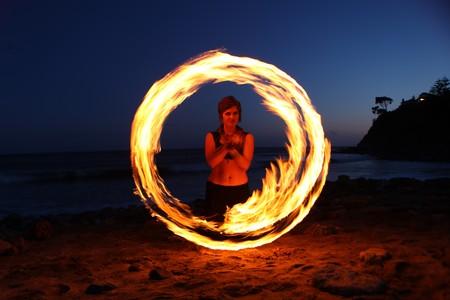 Beautiful Fire Dance Along the Beach in the Dark