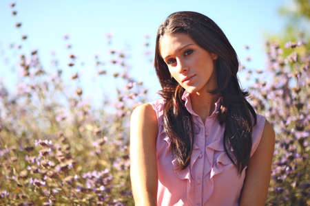 sundress: Young Beautiful Woman in a Field During Summertime