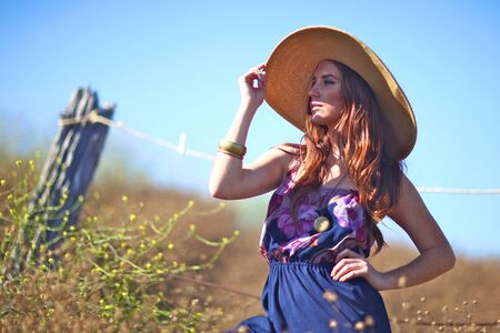 Beautiful Woman in a Field During Summer With Hat