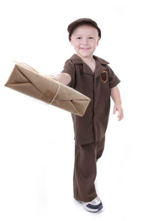 Little Boy Delivering a Package to the Viewer photo