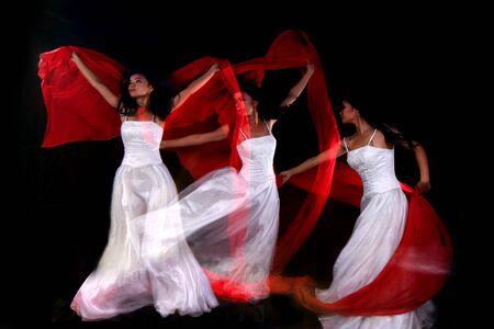multiple exposure: Sfocatura movimento creativo pi� esposizione di donna ballando Archivio Fotografico