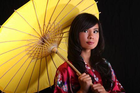 dramatically: Beautiful Asian Woman Posing Dramatically