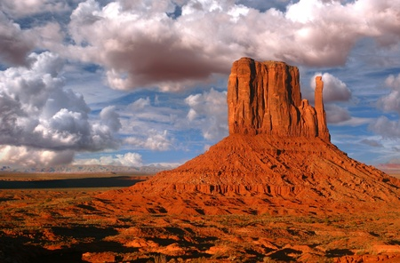 Peaks of rock formations in the Navajo Park of Monument Valley Utah known as The Mittens photo