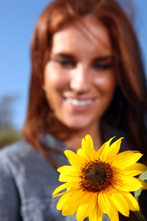 Beautiful Red Haired Woman Outdoors in a Sunflower Field Stock Photo - 11227263