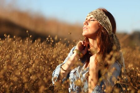 Young Beautiful Woman in a Field During Summertime Stock Photo - 11227268