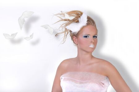 Model With High Key Makeup and Angel Wings photo