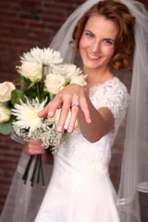 diamong: Beautiful Model Bride With Brick Background Stock Photo