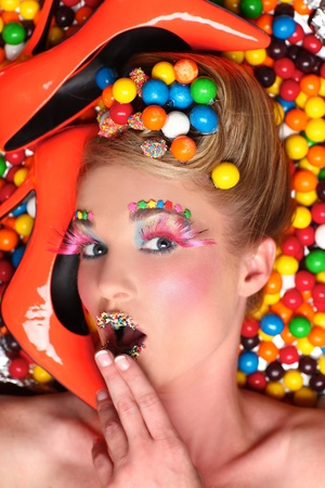 themed: Candy Themed Styled Girl in Studio Stock Photo