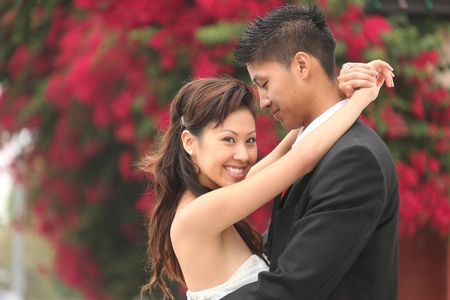 customs and celebrations: Asian American Wedding Couple Outdoors