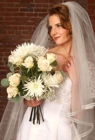 diamong: Beautiful Model Bride With Brick Background Stock Photo