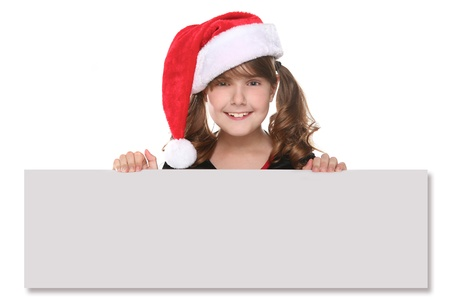 Child in a Christmas Hat With Blank Sign in Hands  photo