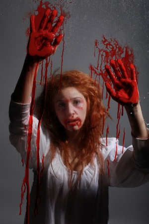 Woman in Horror Situation With Bloody Face Reklamní fotografie - 13100192