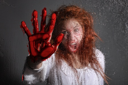 affraid: Woman in Horror Situation With Bloody Face