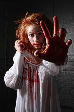 Woman in Horror Situation With Bloody Face Stock Photo - 13100108