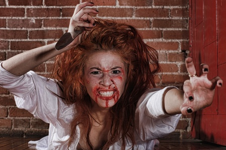 abhorrence: Woman in Horror Situation With Bloody Face