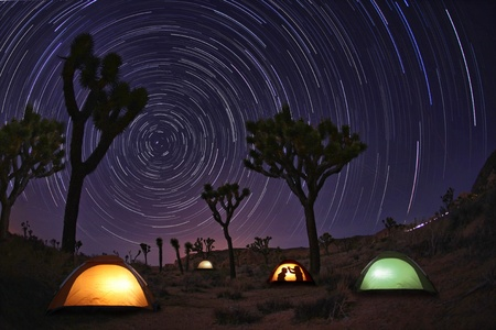 Illuminous Light Painted Landscape of Camping and Stars Foto de archivo