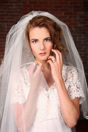 Beautiful Model Bride With Brick Background photo