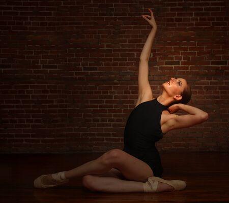 lady slipper: Beautiful Ballerina Posing in Studio on Brick Background