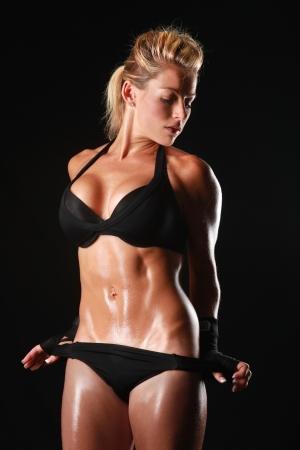 Szőke nő testépítő A szép alak Stock fotó