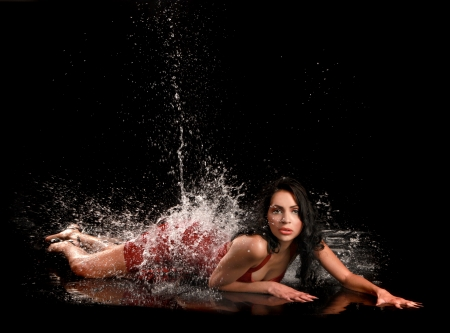 spilled paint: Glamorous Latina Woman Being Splashed With Water
