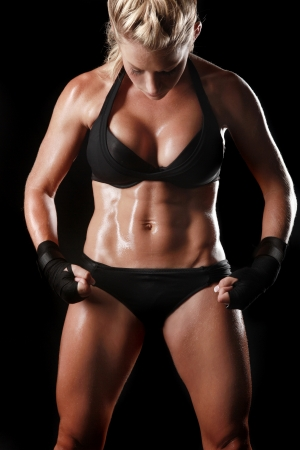fighters: Intense Female With Boxing Gear Stock Photo