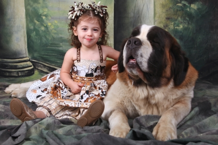 Child and Her Saint Bernard Puppy Dog photo