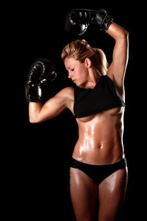fitness model: Intense Female With Boxing Gear Stock Photo