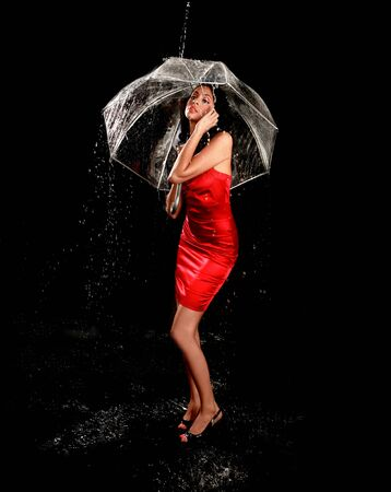 Hispanic Woman in the Rain With Clear Umbrella photo